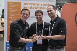 Joey Durham/Amazon Robotics (right) hands over the award of the Amazon Picking Challenge to Dr. Hernandez Corbato (middle) and Mr. van Deurzen from Team Delft. ©Amazon